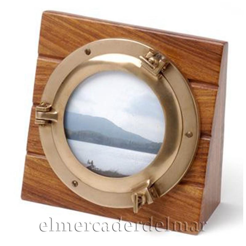 Portafotos con ojo de buey sobre taco de madera
